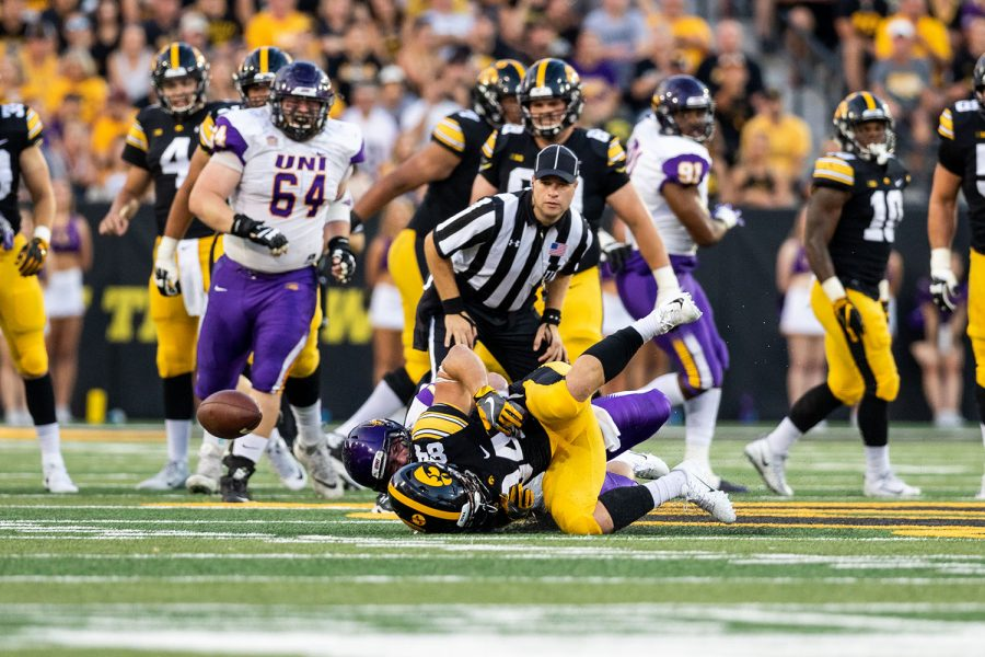 Iowa+Hawkeyes+wide+receiver+Nick+Easley+%2884%29+is+taken+to+the+turf+as+the+ball+bounces+away+during+a+game+against+Northern+Iowa+at+Kinnick+Stadium+on+Saturday%2C+Sept.+15%2C+2018.+The+Hawkeyes+defeated+the+Panthers+38%E2%80%9314.+