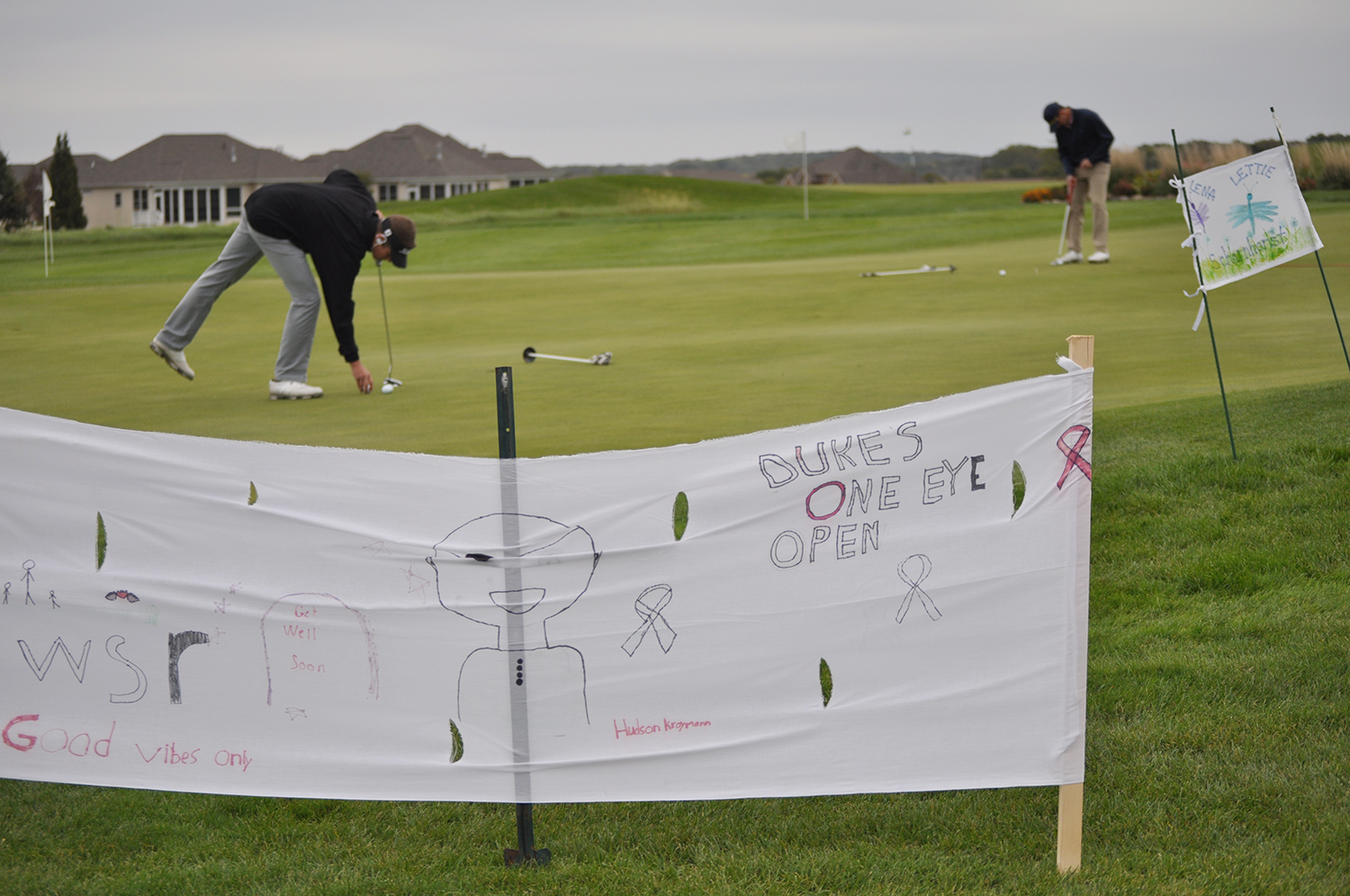 A banner made in honor of the kids at the Stead Family Children's Hospital waves in the wind at Dukie's One Eye Open, a charitable golf tournament in Waverly, Iowa, on Sept. 28.
