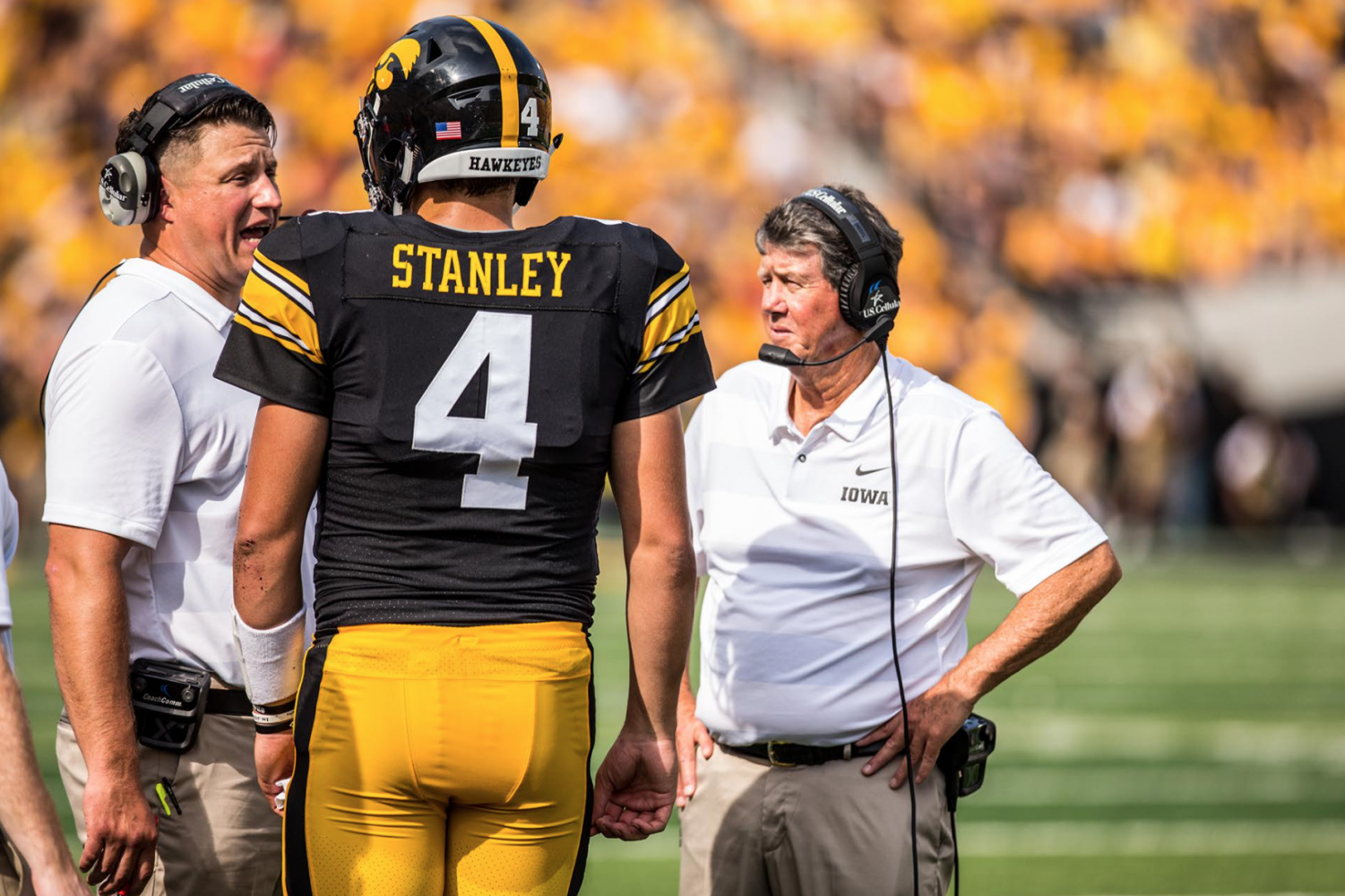 Iowa quarterback Nate Stanley talks with offensive coordinator Brian Ferentz during Iowa's game against Northern Illinois at Kinnick Stadium on Sept. 1, 2018. The Hawkeyes defeated the Huskies 33-7.