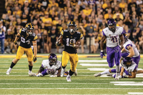 Iowa Hawkeyes running back Mekhi Sargent (10) breaks away from tacklers during a game against Northern Iowa at Kinnick Stadium on Saturday, Sept. 15, 2018. The Hawkeyes defeated the Panthers 38–14.