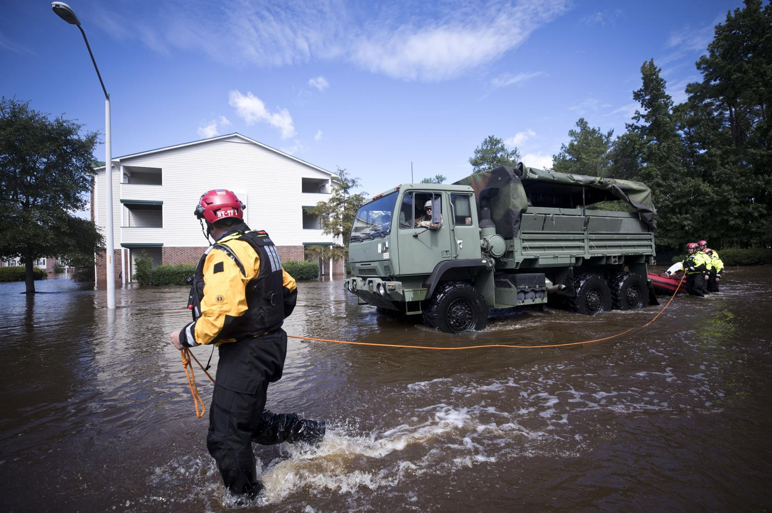 New York Urban Search and Rescue team members, along with members of the N.C. Army National Guard, prepare to evacuate residents at the Heritage at Fort Bragg Apartments in Spring Lake, N.C., Tuesday Sept. 18, 2018. (Julia Wall/Raleigh News & Observer/TNS)