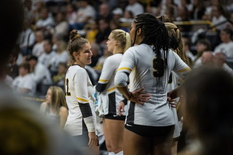 Iowa's Emily Bushman talks with her teammates during a volleyball match between Iowa and Michigan State on Friday, September 21, 2018. The Hawkeyes defeated the Spartans, 3 sets to 0.