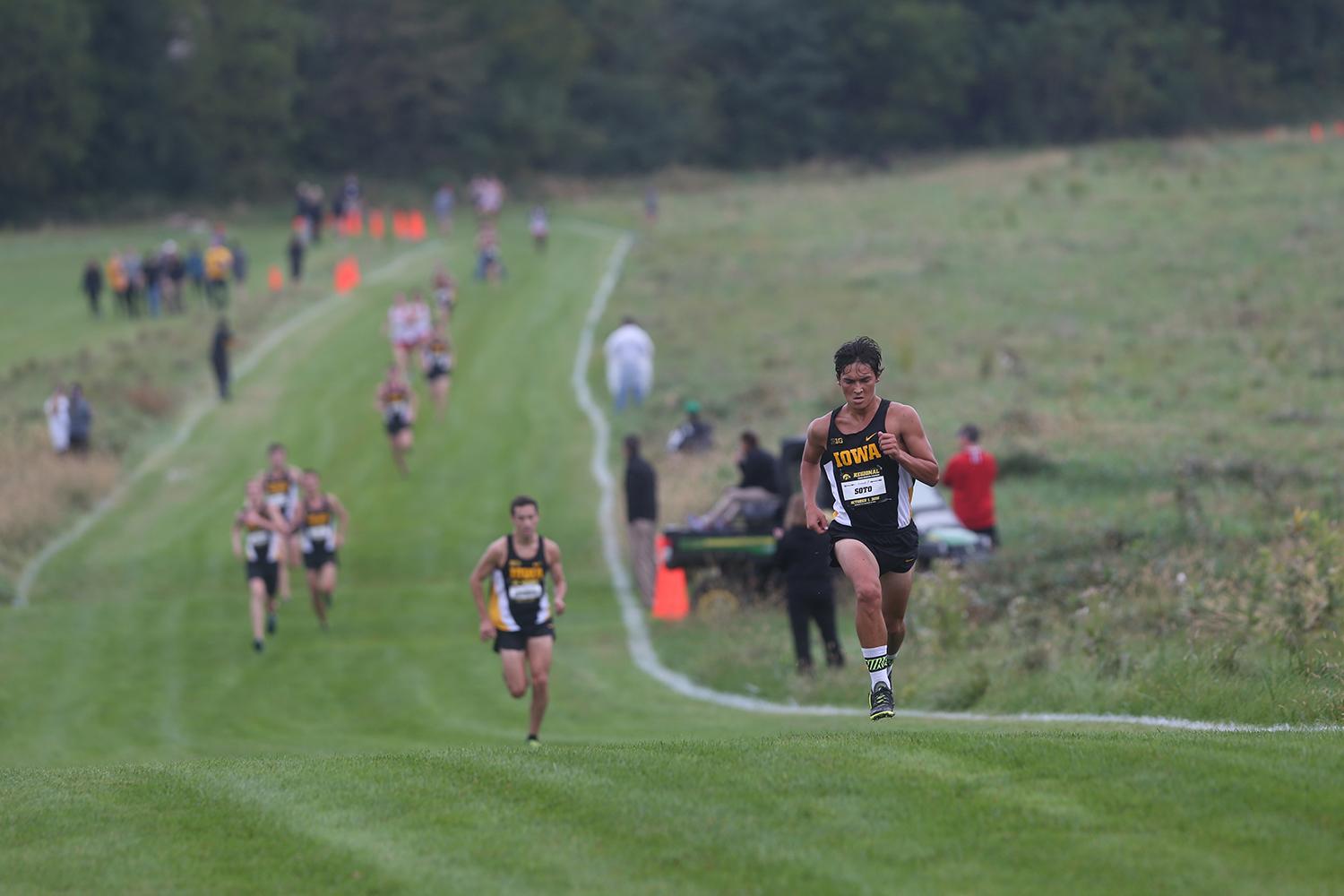 Hawkeye runner Daniel Soto sprints towards the finish line in 2nd place at Ashton Cross Country Course on Oct. 1, 2016.