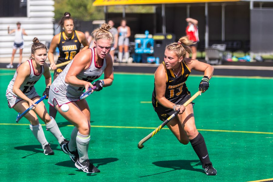 Iowa+forward+Leah+Zellner+fights+for+control+of+the+ball+during+a+field+hockey+match+against+Penn+on+Friday%2C+Sept.+14%2C+2018.+The+Hawkeyes+defeated+the+Quakers+3%E2%80%930.