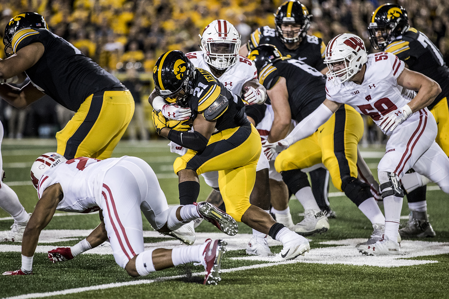 Iowa running back Ivory Kelly-Martin carries the ball during Iowa's game against Wisconsin at Kinnick Stadium on Saturday, Sept. 22, 2018. The Badgers defeated the Hawkeyes 28-17.