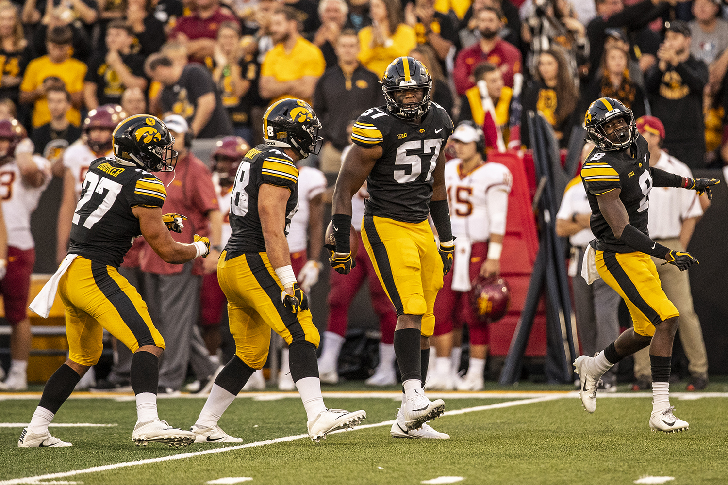 Iowa defensive players celebrate a stop during Iowa's game against Iowa State at Kinnick Stadium on Saturday, Sept. 8, 2018. The Hawkeyes defeated the Cyclones 13-3.