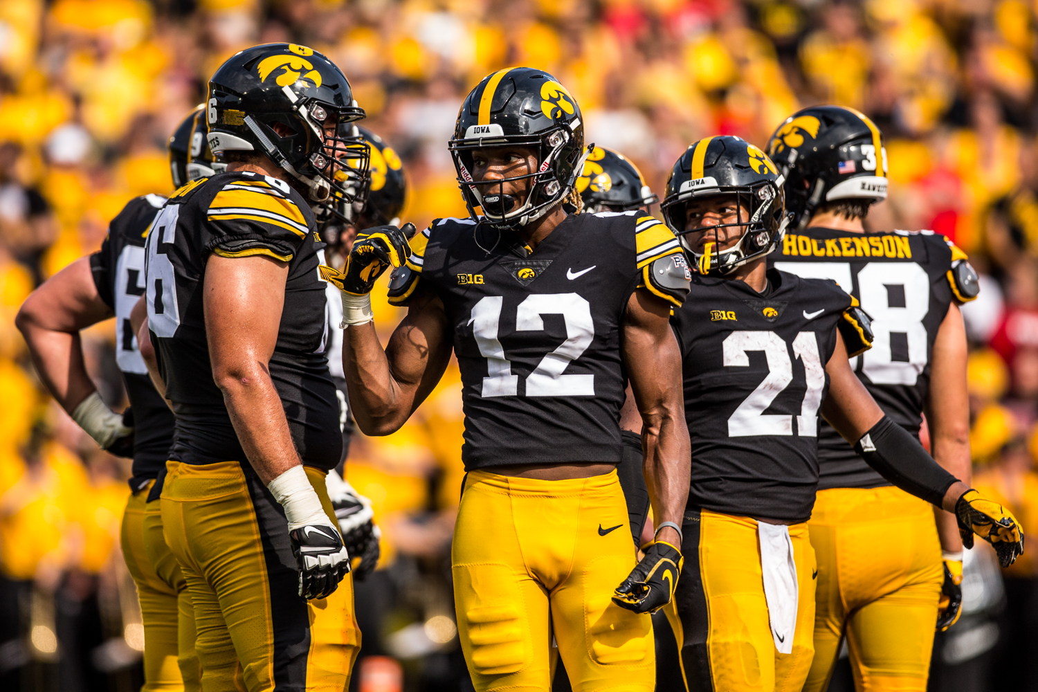 Iowa wide receiver Brandon Smith talks with teammates in the huddle during Iowa's game against Northern Illinois at Kinnick Stadium on Saturday, September 1, 2018. during Iowa's game against Northern Illinois at Kinnick Stadium on Saturday, September 1, 2018. The Hawkeyes defeated the Huskies 33-7.