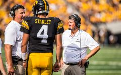 Iowa quarterback Nate Stanley talks with offensive coordinator Brian Ferentz during Iowa's game against Northern Illinois at Kinnick Stadium on Saturday, Sept. 1, 2018.