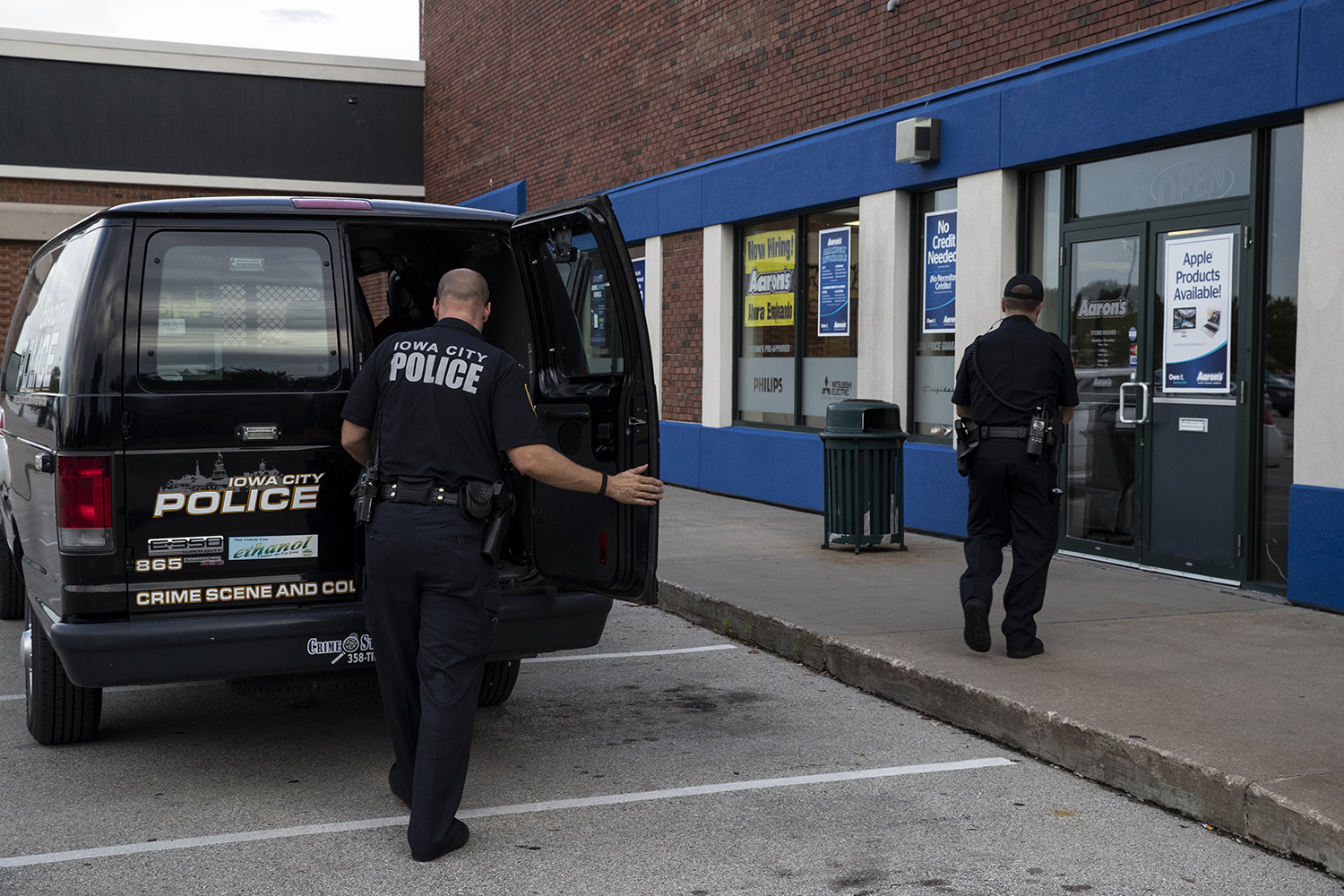 Police investigate the scene at the Iowa City Marketplace after reports of shots fired in the mall on Monday, Sept. 3.
