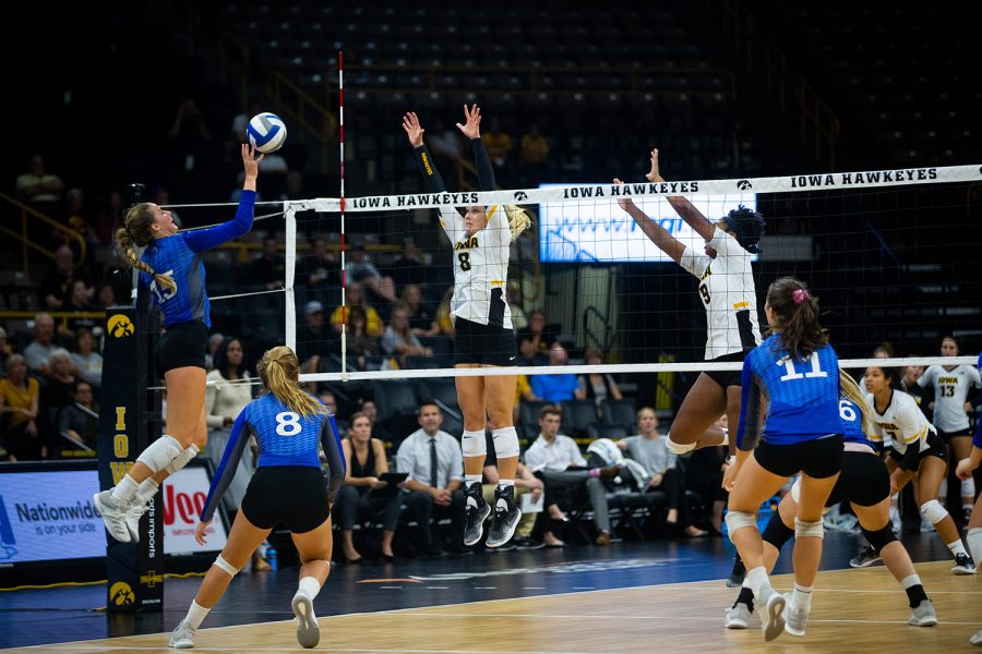 Reghan Coyle and Amiya Jones jump to block a spike during Iowa's match against Eastern Illinois on Sunday, September 9, 2018 at Carver-Hawkeye Arena. The Hawkeyes won the match 3-0.(Megan Nagorzanski/ The Daily Iowan)