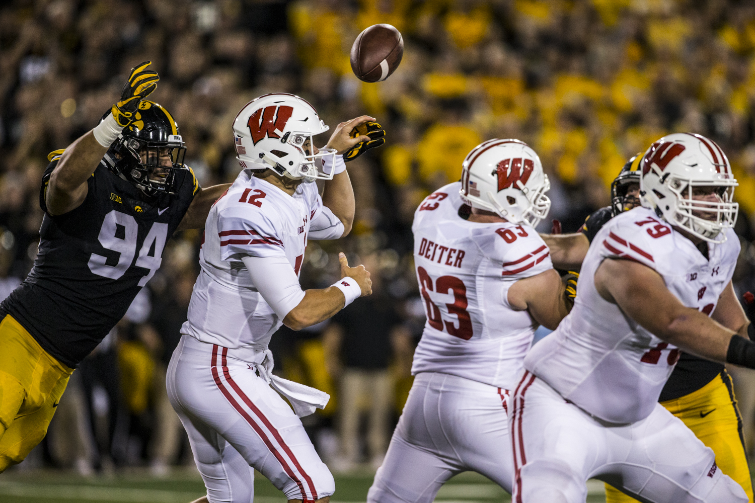 Iowa+defensive+lineman+A.J.+Epenesa+deflects+a+pass+during+Iowa%27s+game+against+Wisconsin+at+Kinnick+Stadium+on+Saturday%2C+September+22%2C+2018.+The+Badgers+defeated+the+Hawkeyes+28-17.