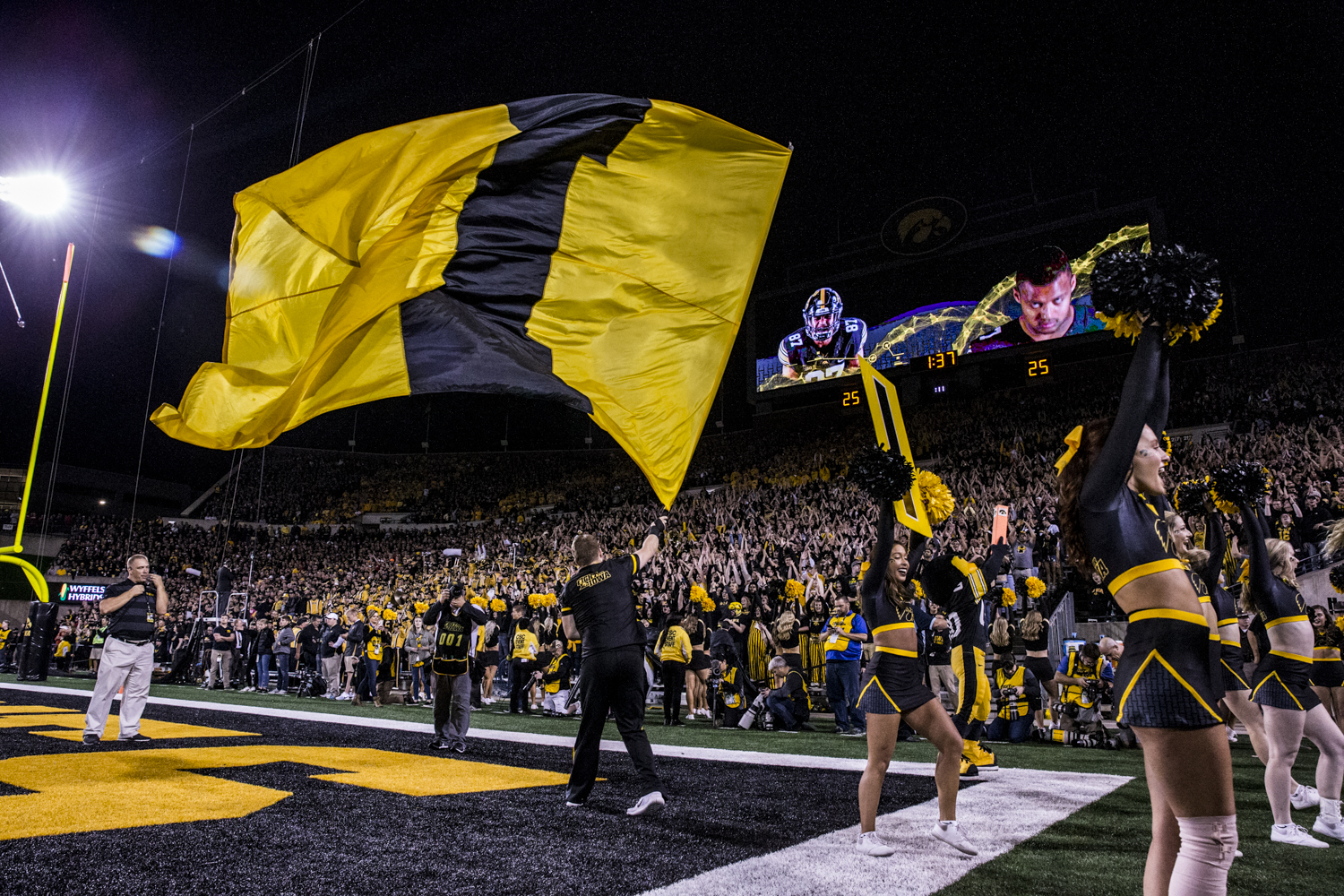 A+member+of+the+Iowa+spirit+squad+waves+an+%22I%22+flag+during+Iowa%27s+game+against+Wisconsin+at+Kinnick+Stadium+on+Saturday%2C+September+22%2C+2018.+The+Badgers+defeated+the+Hawkeyes+28-17.