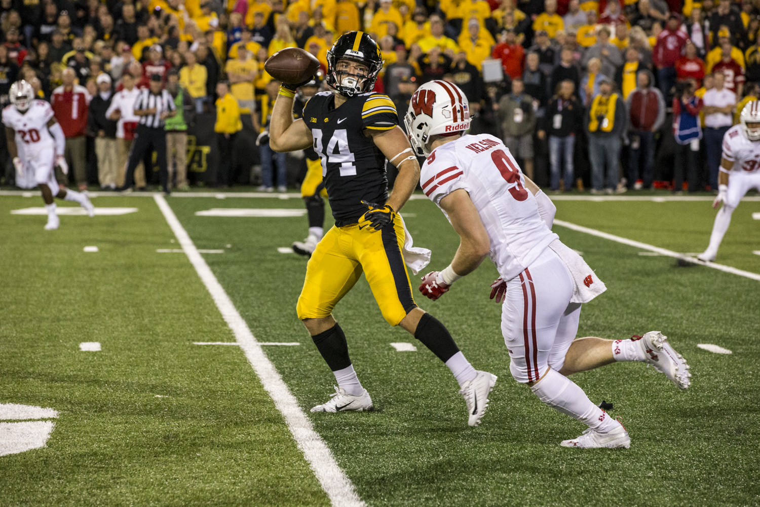 Iowa+wide+receiver+Nick+Easley+laterals+the+football+on+the+final+play+of+the+game+during+Iowa%27s+game+against+Wisconsin+at+Kinnick+Stadium+on+Saturday%2C+September+22%2C+2018.+The+Badgers+defeated+the+Hawkeyes+28-17.