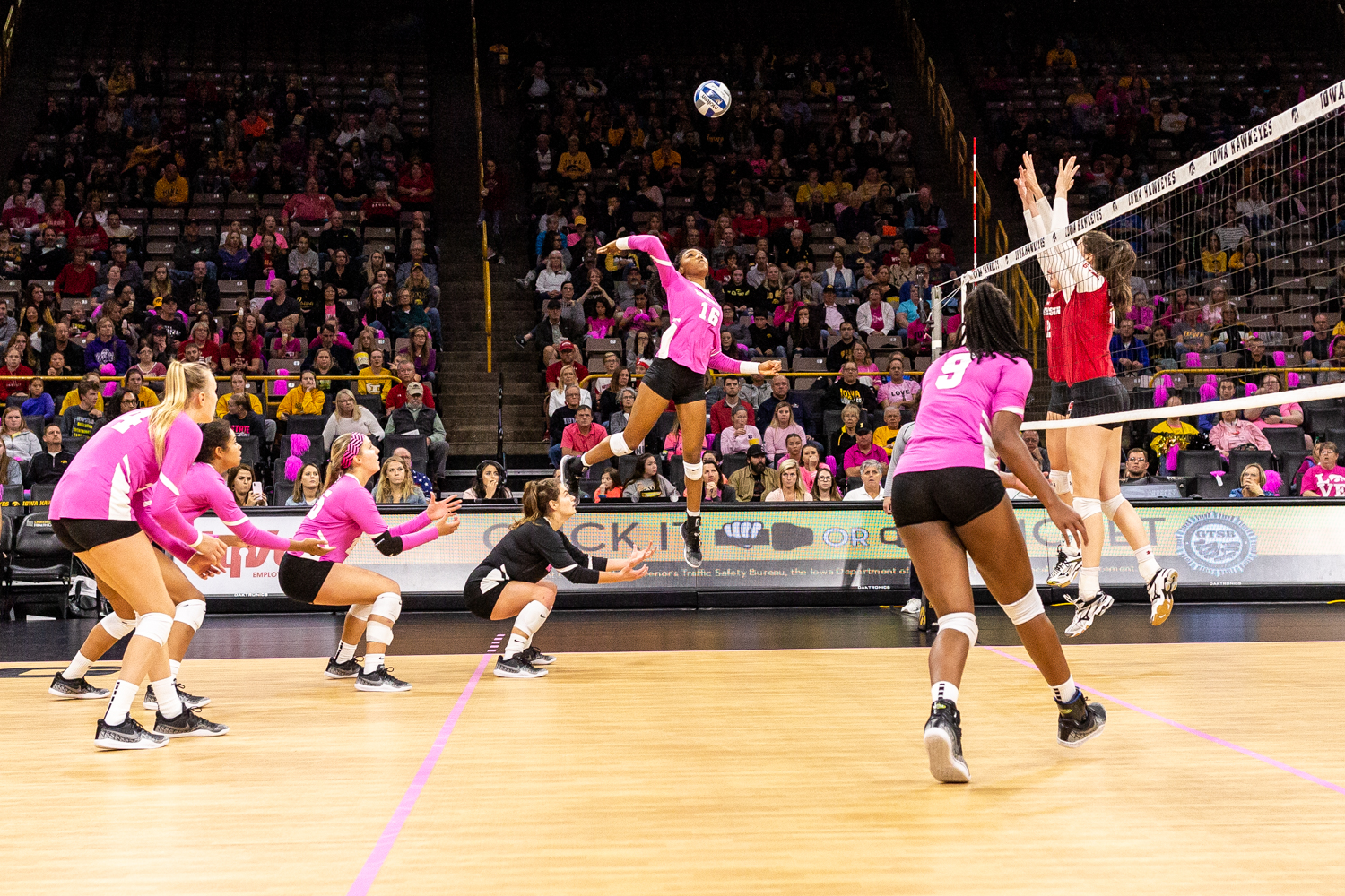 Iowa's Taylor Louis winds up to spike the ball during a volleyball match against Wisconsin on Saturday, Oct. 6, 2018. The Hawkeyes defeated the number six ranked Badgers 3-2.
