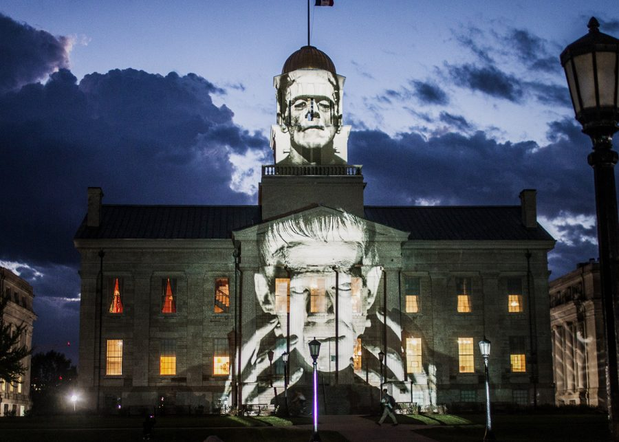 """The Old Capitol building is lit up with a Frankenstein light display on Wednesday, Oct. 3, 2018. International light artist Gerry Hofstetter chose the building as a backdrop to feature artwork included in his """"Light Art Grand Tour USA."""""""