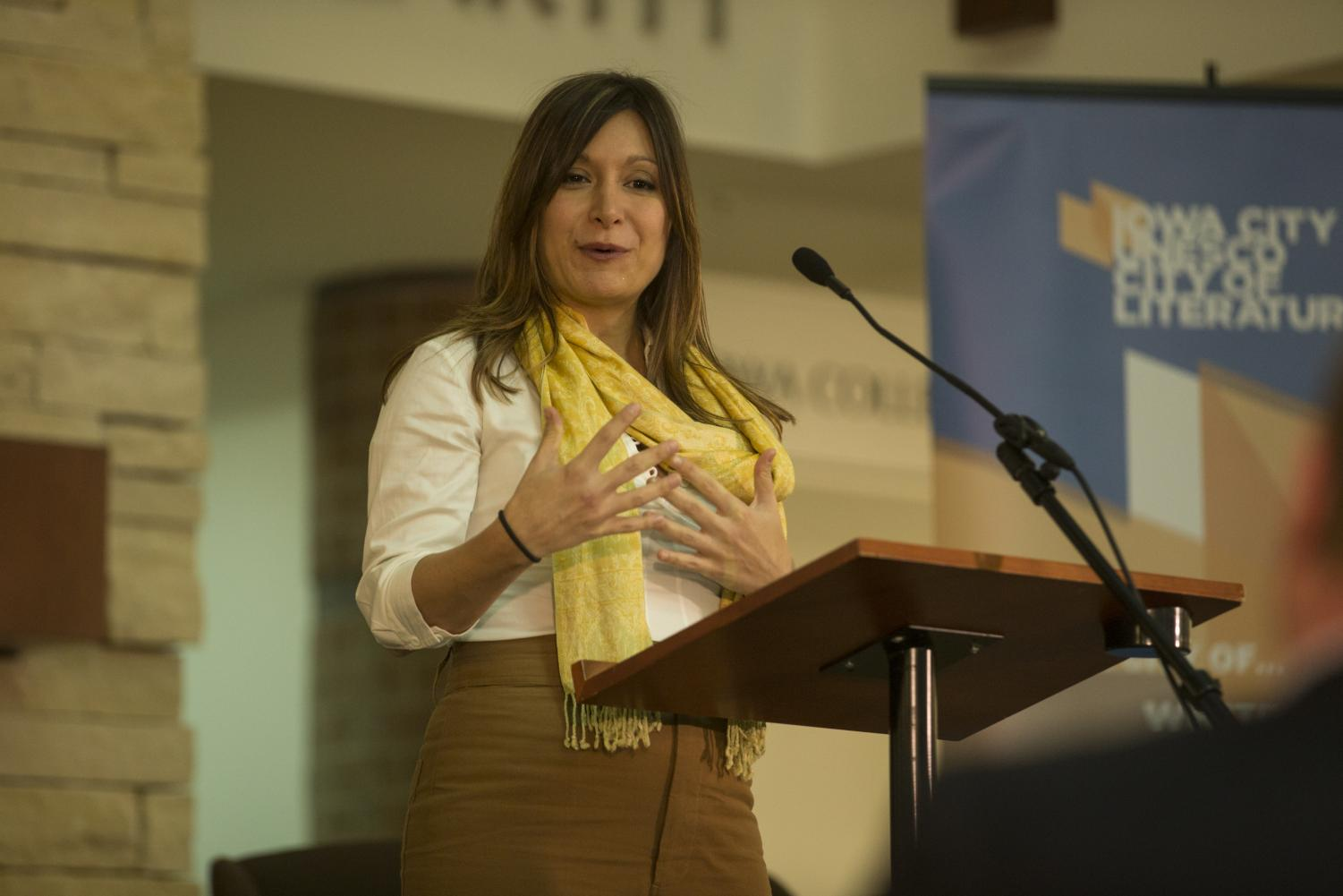 Dina Nayeri, graduate of the Iowa Writers' Workshop, addresses the audience as she accepts the 2018 Paul Engle Prize at the Coralville Public Library on Oct. 4, 2018. Nayeri receives this award for her novel Refuge, which details her experience as a refugee and the experiences of many others.