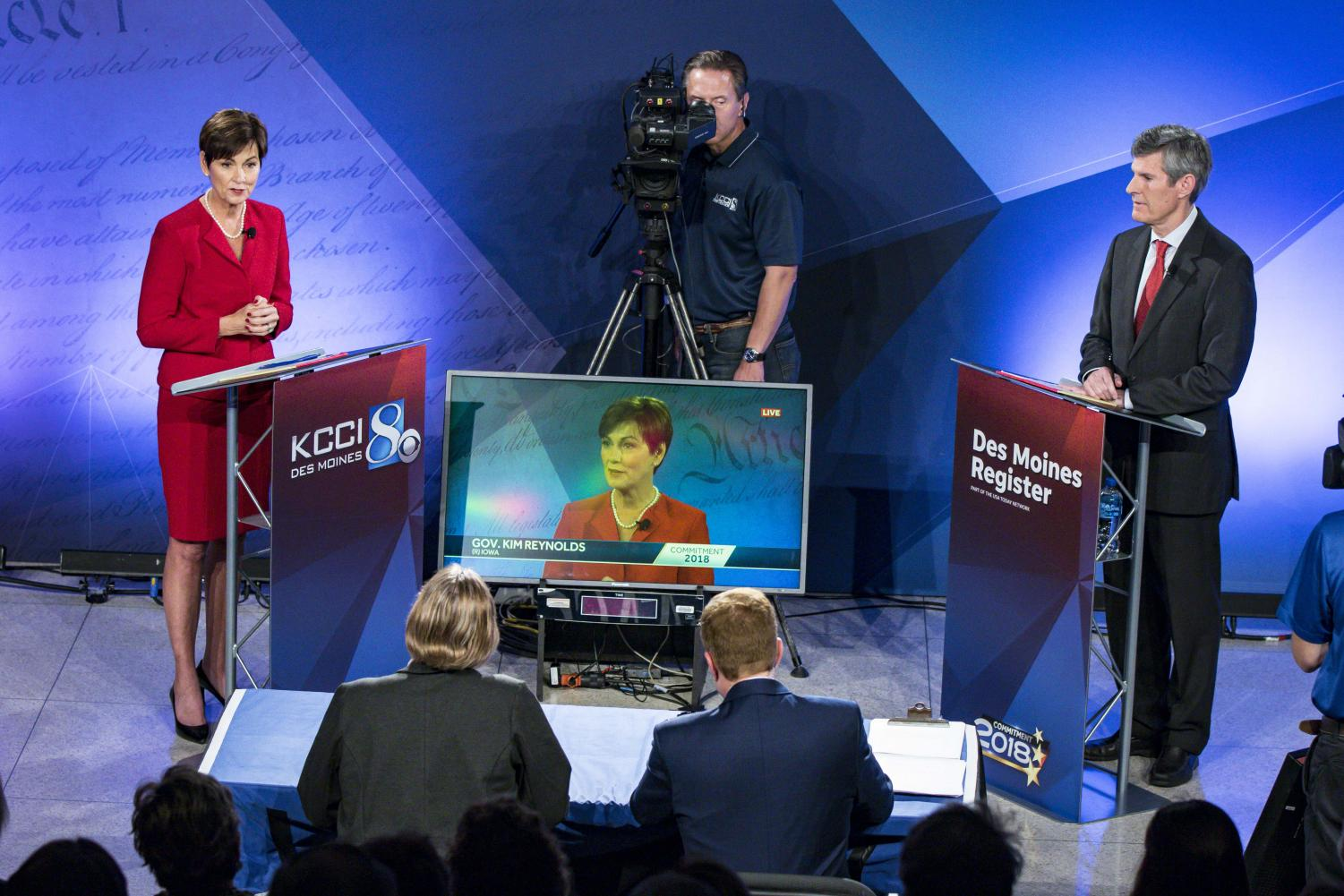 Republican Gov. Kim Reynolds and Democratic contender Fred Hubbell debate at Des Moines Area Community College on Oct. 10, 2018.