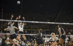 Sophomore Brie Orr (left) and freshman Hannah Clayton jump to block the ball during Iowa volleyball against Purdue at Carver-Hawkeye Arena in Iowa City on Saturday, Oct. 13, 2018.