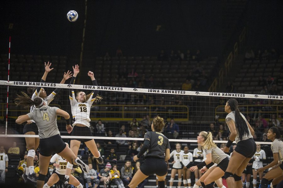 Sophomore+Brie+Orr+%28left%29+and+freshman+Hannah+Clayton+jump+to+block+the+ball+during+Iowa+volleyball+against+Purdue+at+Carver-Hawkeye+Arena+in+Iowa+City+on+Saturday%2C+Oct.+13%2C+2018.+