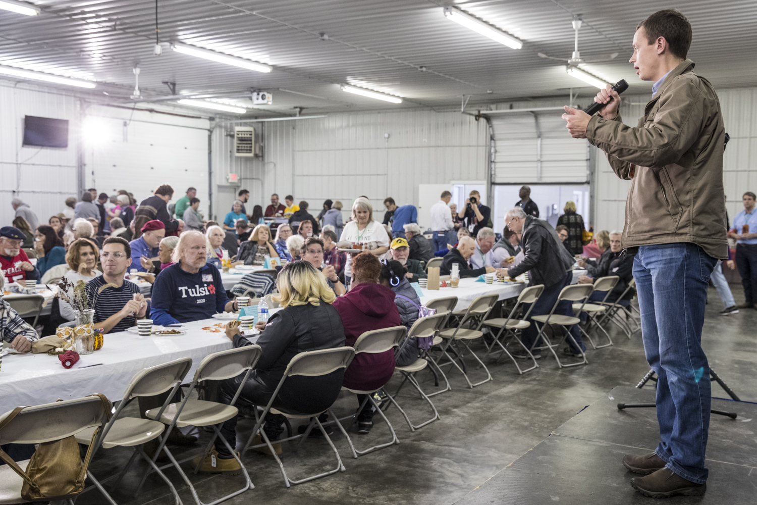 Democratic candidate for Iowa Auditor of State Rob Sand speaks during the Johnson County Democratic Party Fall Barbecue at the Johnson County Fairgrounds on Sunday Oct. 14, 2018.