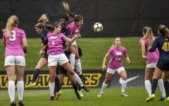 Players fight for a cross during Iowa's game against Michigan at The Hawkeye Soccer Complex on Sunday, Oct. 14, 2018. The Hawkeyes defeated the Wolverines 1-0.