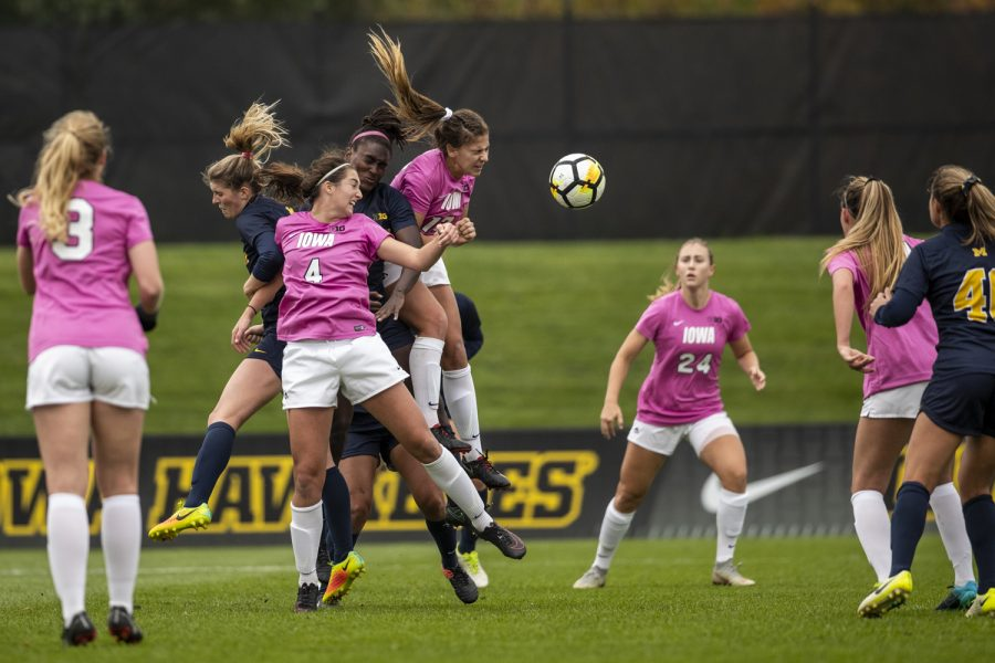Players+fight+for+a+cross+during+Iowa%27s+game+against+Michigan+at+The+Hawkeye+Soccer+Complex+on+Sunday%2C+Oct.+14%2C+2018.+The+Hawkeyes+defeated+the+Wolverines+1-0.