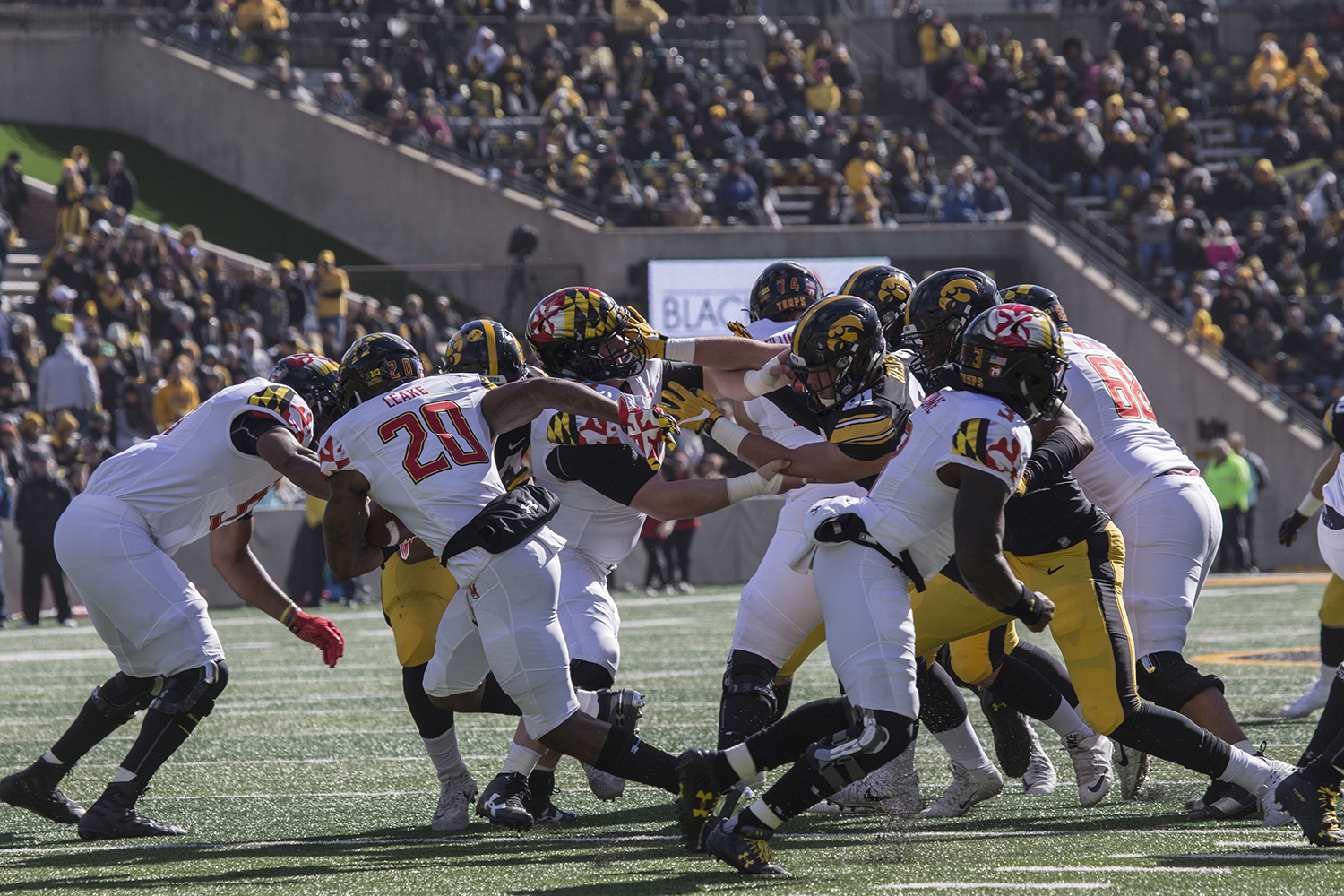 Players+push+each+other+during+the+Iowa+vs.+Maryland+game+at+Kinnick+stadium+on+Saturday+Oct.+20%2C+2018.+The+Hawkeyes+defeated+the+Terrapins+23-0.+