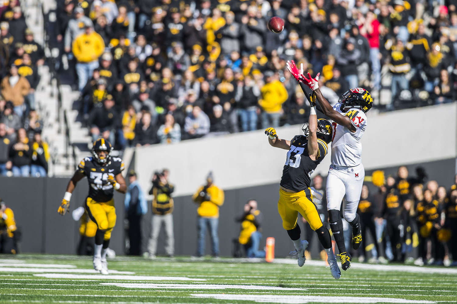 Iowa+defensive+back+Riley+Moss+and+Maryland+wide+receiver+Dontay+Demus+attempt+to+catch+a+Maryland+pass+during+the+Iowa%2FMaryland+homecoming+football+game+at+Kinnick+Stadium+on+Saturday%2C+October+20%2C+2018.+The+Hawkeyes+defeated+the+Terrapins%2C+23-0.+
