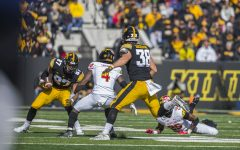 Iowa tight end Noah Fant (87) runs the ball during the Iowa/Maryland homecoming football game at Kinnick Stadium on Saturday, October 20, 2018. The Hawkeyes defeated the Terrapins, 23-0.