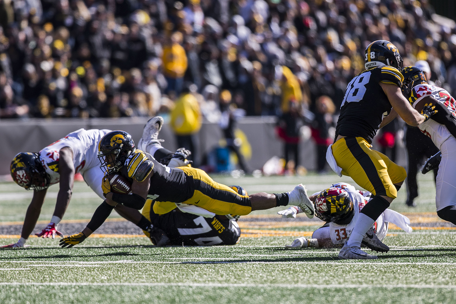 Iowa+running+back+Ivory+Kelly-Martin+dives+with+the+ball+during+the+Iowa%2FMaryland+homecoming+football+game+at+Kinnick+Stadium+on+Saturday%2C+October+20%2C+2018.+The+Hawkeyes+defeated+the+Terrapins%2C+23-0.+