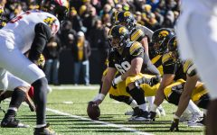 Iowa football's offensive line blocks with friendship
