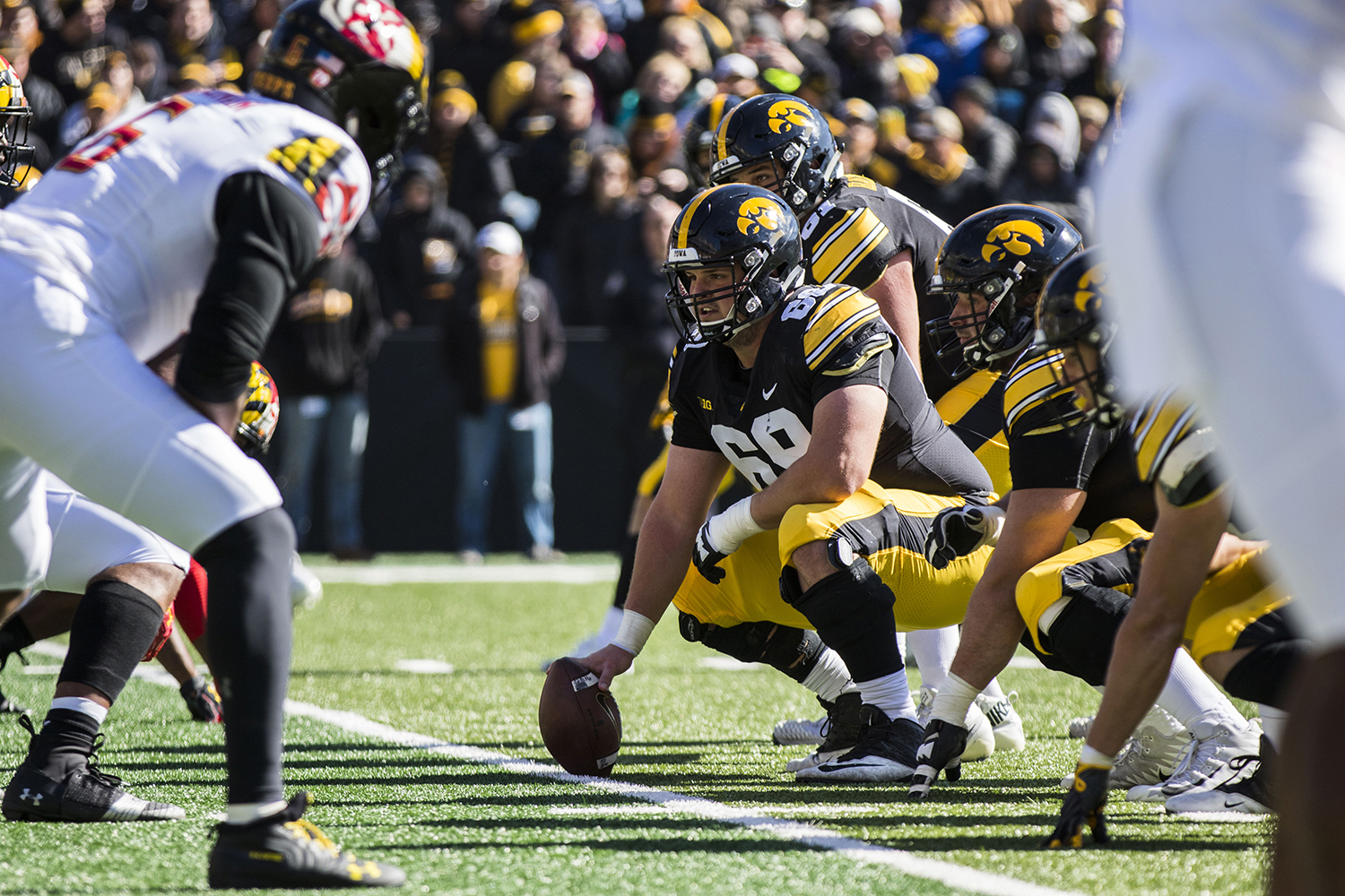 Iowa offensive lineman Keegan Render waits at the line of scrimmage during the Iowa/Maryland homecoming football game at Kinnick Stadium on Saturday, Oct. 20, 2018. The Hawkeyes defeated the Terrapins, 23-0.