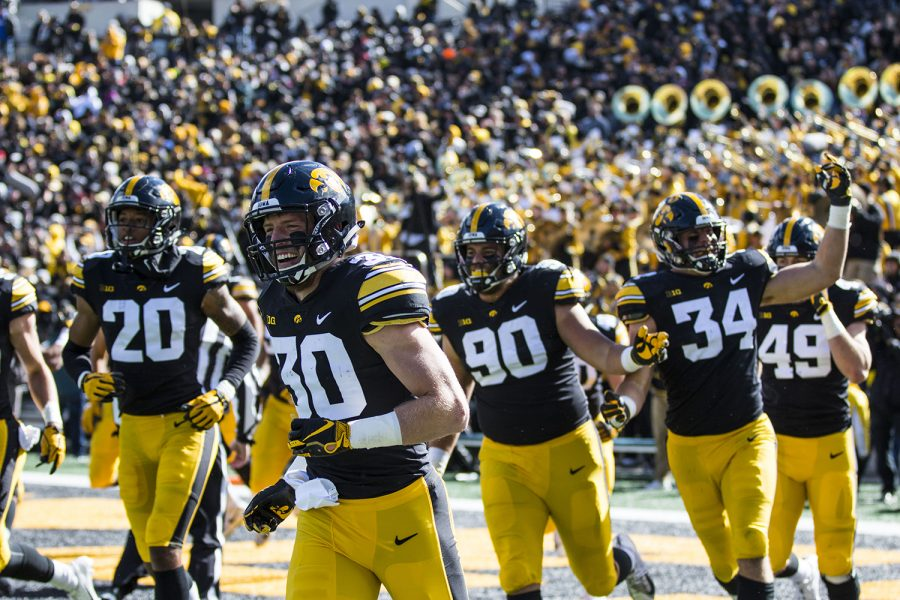 Iowa+football+players+exit+the+field+after+scoring+a+touchdown+on+a+fumble+recovery+during+the+Iowa%2FMaryland+homecoming+football+game+at+Kinnick+Stadium+on+Saturday%2C+Oct.+20%2C+2018.+The+Hawkeyes+defeated+the+Terrapins%2C+23-0.+