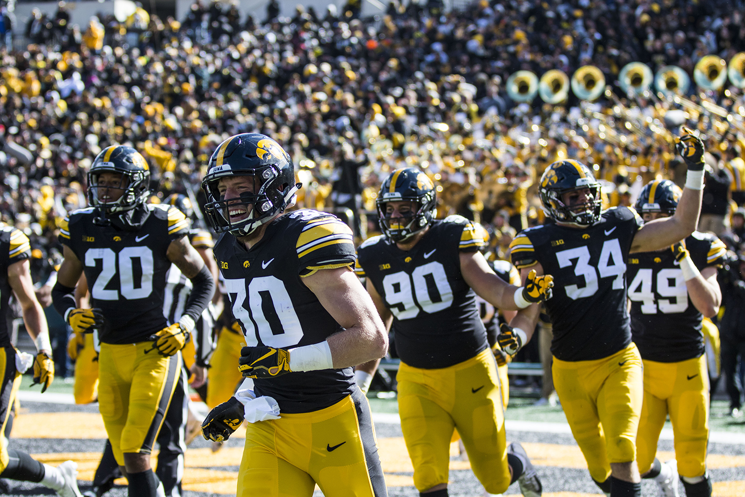 Iowa football players exit the field after scoring a touchdown on a fumble recovery during the Iowa/Maryland homecoming football game at Kinnick Stadium on Saturday, Oct. 20, 2018. The Hawkeyes defeated the Terrapins, 23-0.