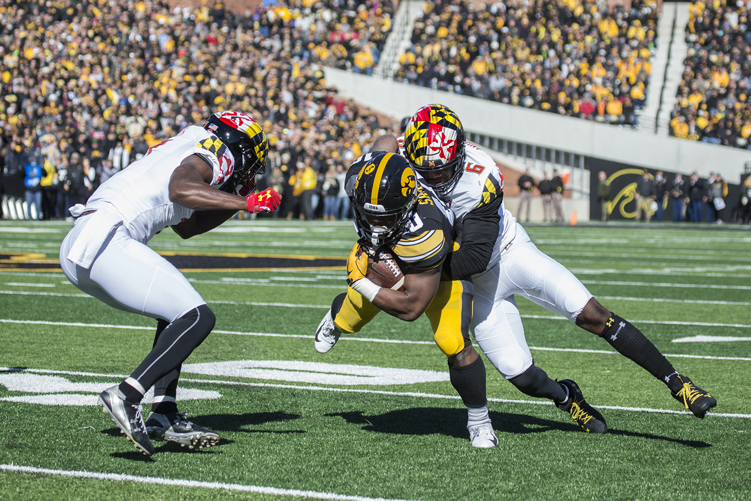 Iowa+running+back+Mekhi+Sargent+is+tackled+during+a+football+game+between+Iowa+and+Maryland+in+Kinnick+Stadium+on+Saturday%2C+October+20%2C+2018.+The+Hawkeyes+defeated+the+Terrapins%2C+23-0.+