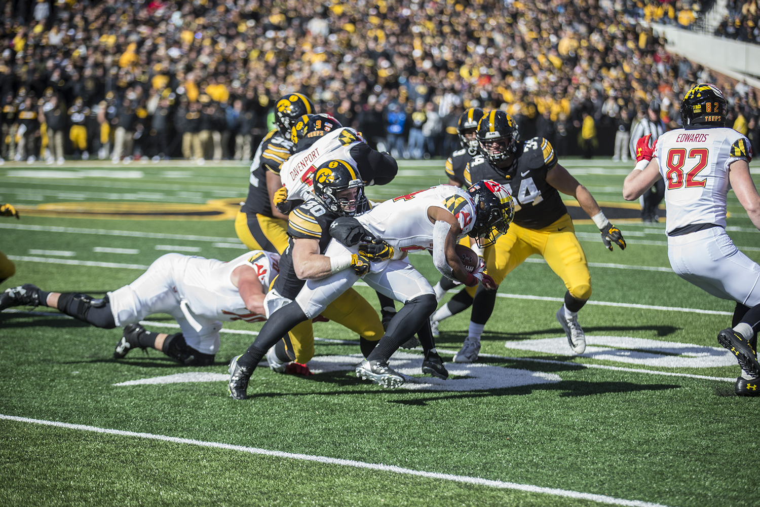 Iowa+defenders%2C+led+by+defensive+back+Jake+Gervase%2C+converge+on+Maryland+running+back+Ty+Johnson+during+a+football+game+between+Iowa+and+Maryland+in+Kinnick+Stadium+on+Saturday%2C+October+20%2C+2018.+The+Hawkeyes+defeated+the+Terrapins%2C+23-0.+
