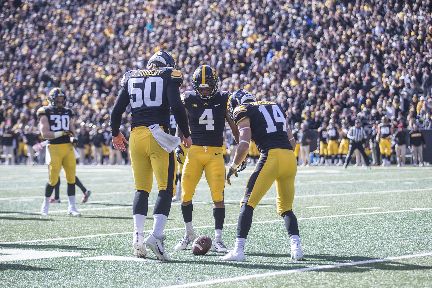 The+Iowa+special+teams+unit+surrounds+the+football+after+a+punt+during+a+football+game+between+Iowa+and+Maryland+in+Kinnick+Stadium+on+Saturday%2C+October+20%2C+2018.+The+Hawkeyes+defeated+the+Terrapins%2C+23-0.+
