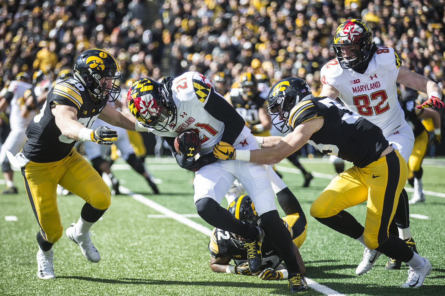 Iowa+wide+receiver+Darryl+Jones+is+tackled+during+a+football+game+between+Iowa+and+Maryland+in+Kinnick+Stadium+on+Saturday%2C+October+20%2C+2018.+The+Hawkeyes+defeated+the+Terrapins%2C+23-0.+
