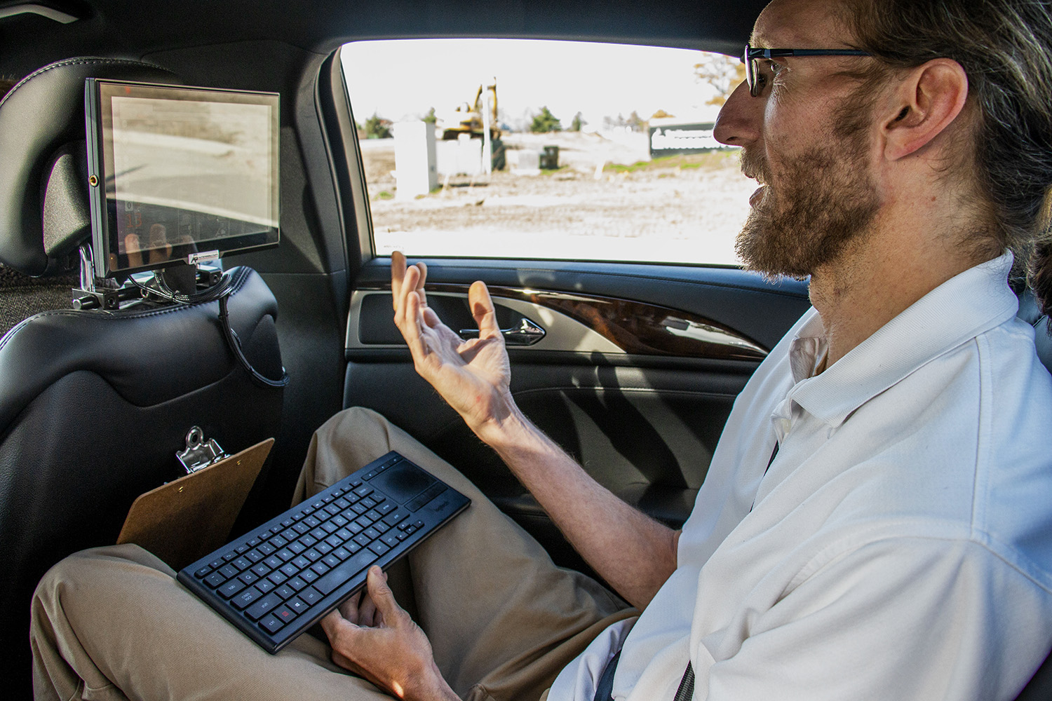 Engineer Steve Cable discusses the functions of the new Lincoln MKZ at The National Advanced Driving Simulator on Wednesday, October 24, 2018. The researchers are creating new softwares to enhance autonomous features in Tesla and Lincoln MKZ. (Katina Zentz/The Daily Iowan)