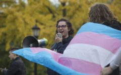 Margo O'Neill addresses the crowd during a transgender rights rally on the Pentacrest on Thursday, Oct. 25, 2018. Protesters gathered to promote rights in light of the upcoming elections.