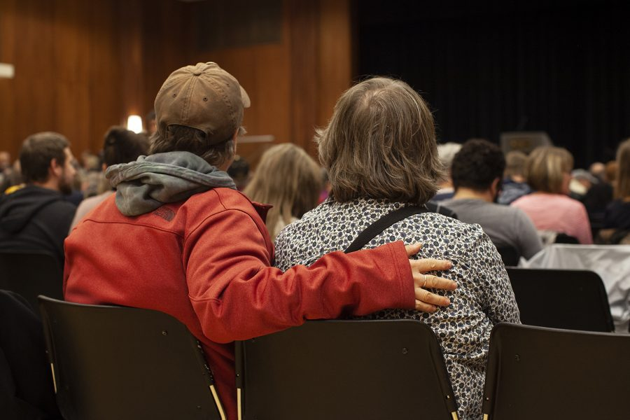 Community members comforted each other during a vigil for the shootings in Pittsburgh and Louisville in the Iowa Memorial Union on Tuesday, Oct. 30, 2018. Members of the Jewish and African American communities came to mourn the loss of those who were killed in last week's shootings at Kroger and Tree of Life Synagogue.