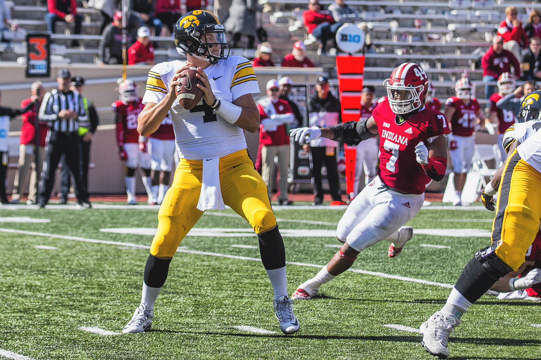 Indiana linebacker Reakwon Jones runs toward Iowa quarterback Nate Stanley during Iowa's game at Indiana at Memorial Stadium in Bloomington on Saturday, Oct. 13, 2018. The Hawkeyes beat the Hoosiers 42-16.