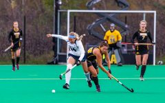 Iowa midfielder Mya Christopher battles for possession during a field hockey match against Penn State on Friday, Oct. 12, 2018.