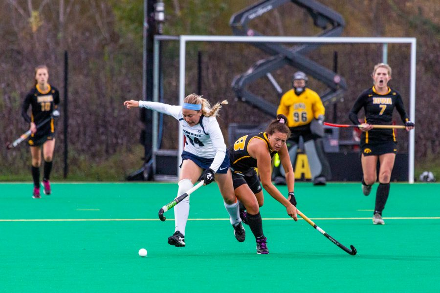 Iowa+midfielder+Mya+Christopher+battles+for+possession+during+a+field+hockey+match+against+Penn+State+on+Friday%2C+Oct.+12%2C+2018.