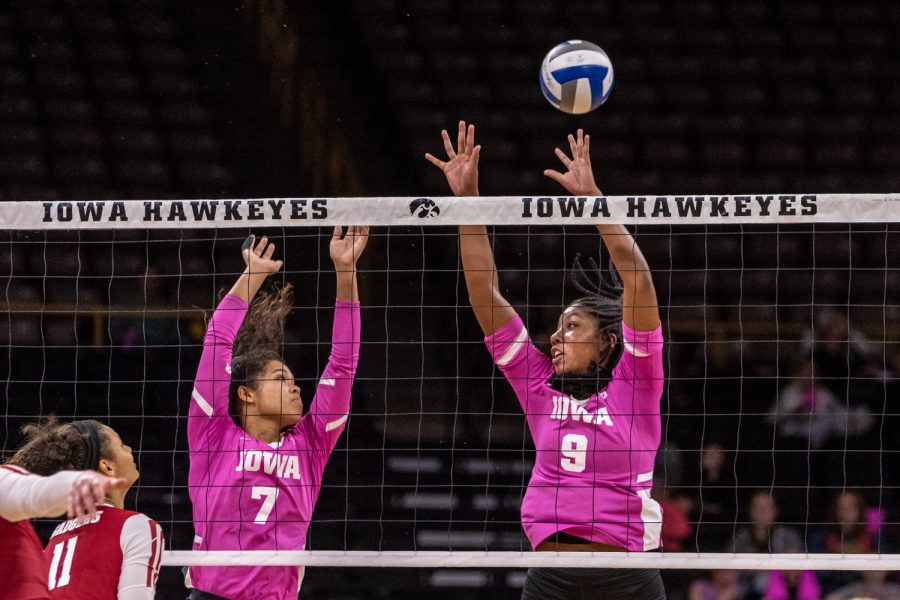Iowa%27s+Brie+Orr+and+Amiya+Jones+try+to+block+the+ball+during+a+volleyball+match+against+Wisconsin+on+Saturday%2C+Oct.+6%2C+2018.+The+Hawkeyes+defeated+the+number+six+ranked+Badgers+3-2.+