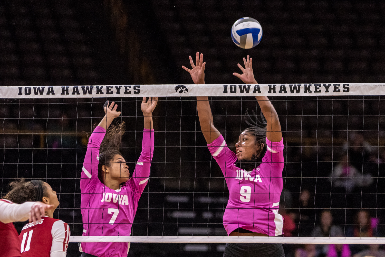 Iowa's Brie Orr and Amiya Jones try to block the ball during a volleyball match against Wisconsin on Saturday, Oct. 6, 2018. The Hawkeyes defeated the number six ranked Badgers 3-2.