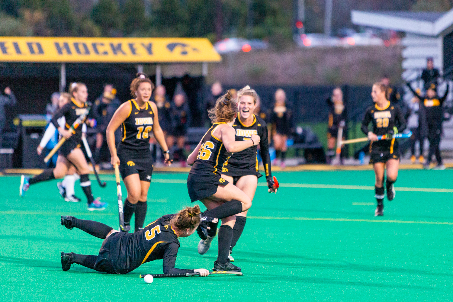 Iowa forward Maddy Murphy bowls over Iowa midfielder Meghan Conroy in celebration after scoring Murphy scored her third goal during a field hockey match against Penn State on Friday, Oct. 12, 2018. The no. 8 ranked Hawkeyes defeated the no. 6 ranked Nittany Lions, 3-2. (David Harmantas/The Daily Iowan)