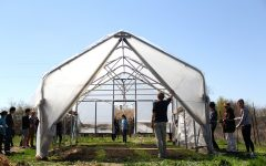Student Gardeners and volunteers help move the greenhouse at the UI Student Garden on Sunday, April 26, 2015.