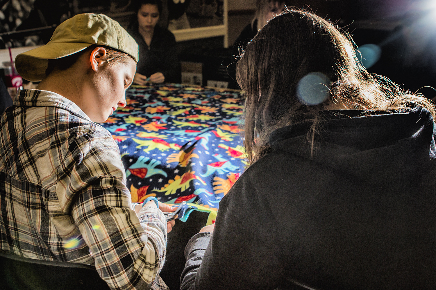From left: UI freshmen Kyle Braeseke and Autumn Johnson cut a blanket during the Cover to Cover event at the IMU on Monday, October 29, 2018. Cover to Cover is a student organization dedicated to providing children in need with blankets and books. (Katina Zentz/The Daily Iowan)