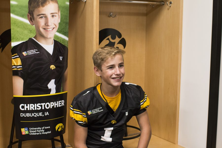 Kid+Captain+Christopher+Turns+smiles+front+of+his+banner+during+Iowa+Football+Kid%27s+Day+at+Kinnick+Stadium+on+Saturday%2C+August+11%2C+2018.+The+2018+Kid+Captains+met+the+Iowa+football+team+and+participated+in+a+behind-the-scenes+tour+of+Kinnick+Stadium.+Each+child%27s+story+will+be+featured+throughout+the+2018+Iowa+football+season.+